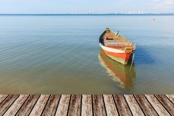 old wood fishing boat at anchor in sea background and mock up