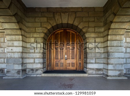 Old wood gate with stone wall