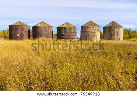 Old wood grain storage bins on the prairies