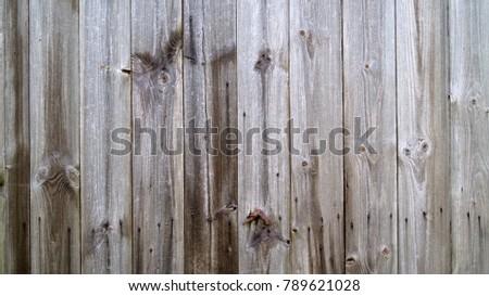 Old wood on a historical plank door on a german barnyard