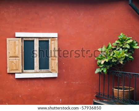 old wood open window on red wall and tree