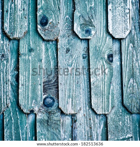 Old wood roof. Blue wooden shingles. Texture of weathered wood.
