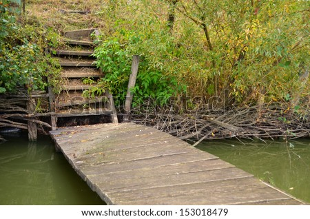 Old wood stairs on lake