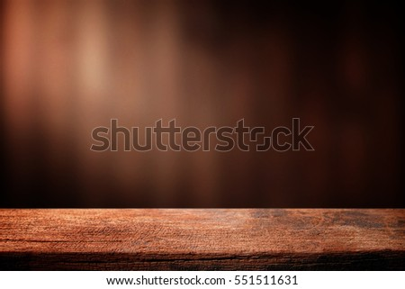 Old wood table with dark brown wall blurred background.  #551511631