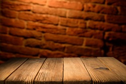 Old wood table with smoke in the dark background.