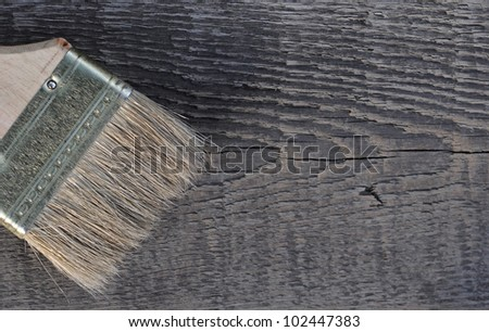 old wood texture and paintbrush