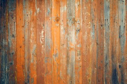 Old wood texture for web background.Wooden texture background. Bright red-orange wooden fence
