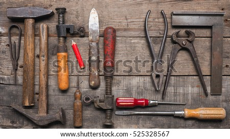 Old wood worker tools on a used wooden table