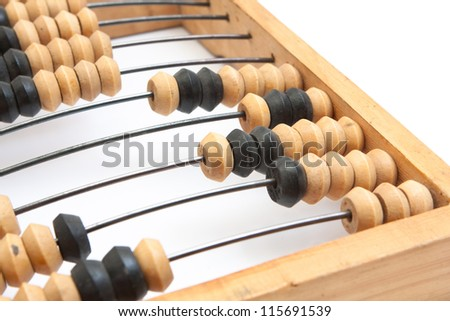 Old wooden abacus with a calculated sum on a white background