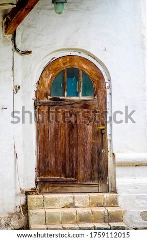 Old wooden arched door entrance. Arched doorway. Arched door