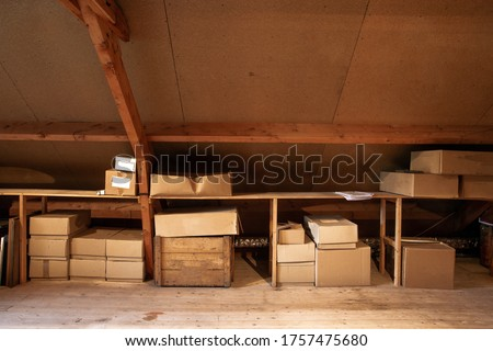 Old wooden attic interior with old cardboard boxes for storage or moving, close-up Stock photo ©
