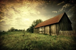 Old wooden bar with red roof over the dramatic sunset. Zalew Zegrzynski, Poland