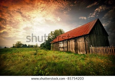 Old wooden bar with red roof over the dramatic sunset. Zalew Zegrzynski, Poland #85754203