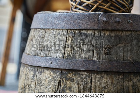 Old wooden barrel on a brown background. Сток-фото ©