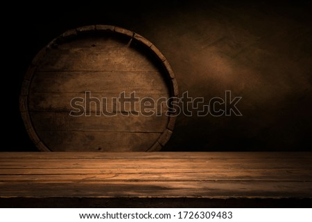 Photo of  Old wooden barrel on a brown background