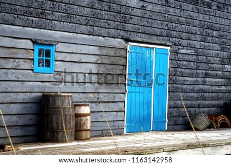 Old wooden barrel on the background of a wooden barn. Selective focus