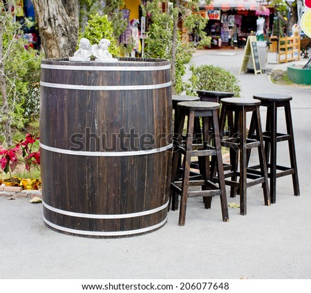 old wooden barrel with wood...