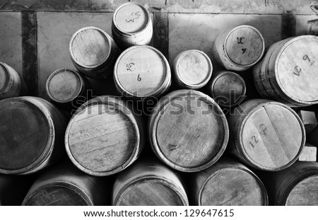 old wooden barrels pilled up in ...