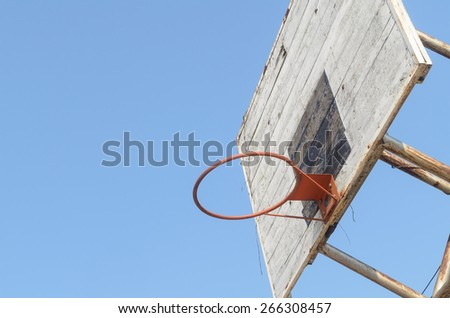 old wooden basketball hoop in the park