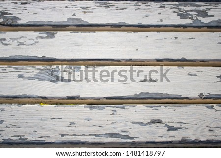 Old wooden bench close up showing the weathered wood #1481418797
