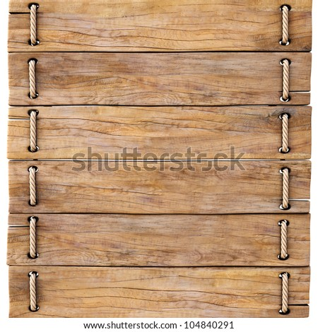 old wooden boards tied together with rope. - stock photo