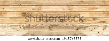 Old wooden boards with cracks and a visible structure as well as gulp and knots. Alder board as a background for various natural designs and compositions. panoramic frame. Stock photo ©