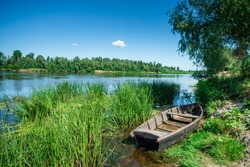 Old wooden boat by the river, beautiful scenery