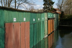 Old Wooden Boat Garages in Green and Brown