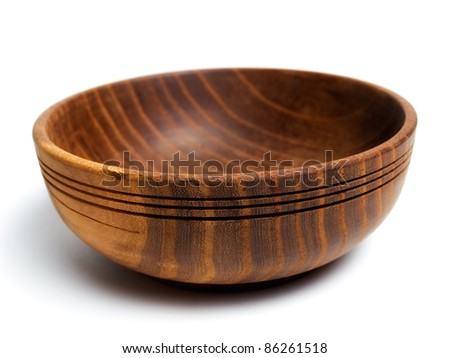 Old wooden bowl on a white background...