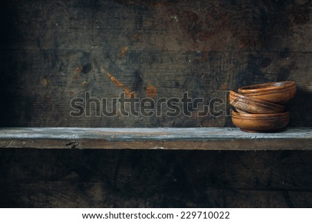 Old wooden bowls, placed on a wooden shelf