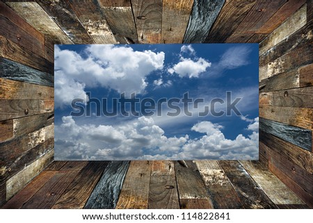 old wooden box frame and blue sky background