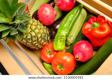 Old wooden box with freshly harvested vegetables and fresh fruits #1530005981