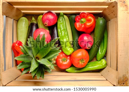 Old wooden box with freshly harvested vegetables and fresh fruits #1530005990