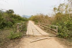 Old wooden bridge in rural area of Laos.