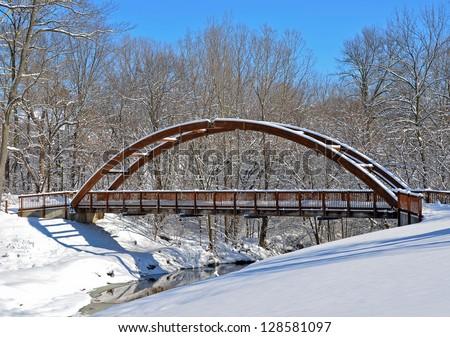 old wooden bridge in winter