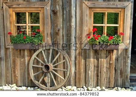 Old wooden building with windows and wheel