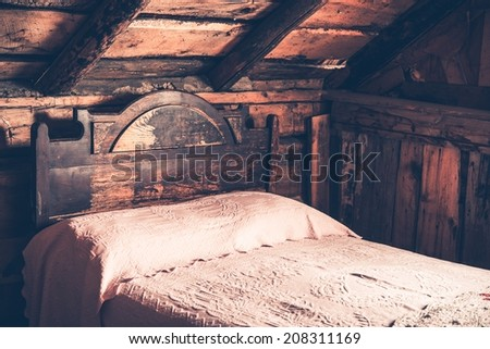 old wooden cabin bedroom. aged...