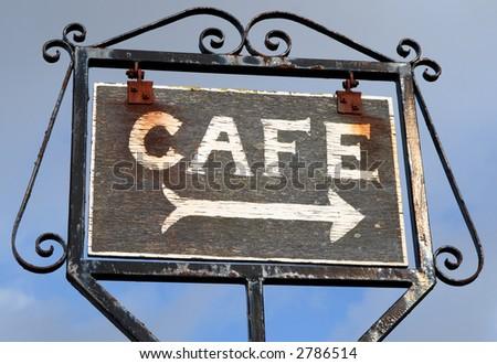 Old wooden cafe sign.
