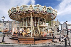 Old wooden carousel in Honfleur, a small medieval harbor in Normandy, France