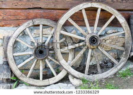 Old wooden carriage wheels closeup #1233386329