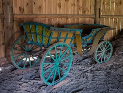 Old wooden cart originally pulled by horses in the open-air Folk Museum of Kolbuszowa, Poland in the summer 2018