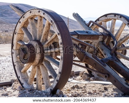 Old wooden cart with wood wagon wheels in the Nevada desert.