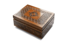 Old wooden carved closed box isolated over white