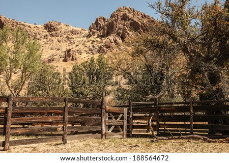 Old wooden cattle corral in high desert landscape/Scenic with Weathered Livestock Corral built of Wooden Boards and Posts in Semi-Desert Terrain/Handmade wooden cattle pen against rocky landscape