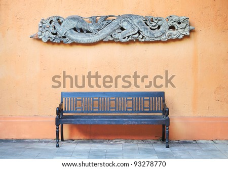 Old wooden chair and snake carving