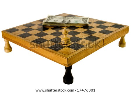 Old wooden chessboard resting upon the rooks, with a pawn and pile of dollars (isolated on white)