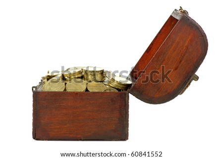 Old wooden chest with golden coins isolated on the white background. Side view