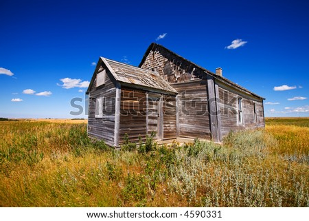 Old wooden church abandoned in a prairie field