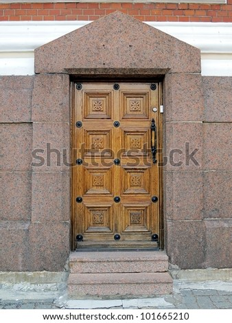 Old wooden church door with metal handles