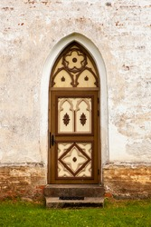 Old wooden church door. Wooden beautifully colored and decorated old door.